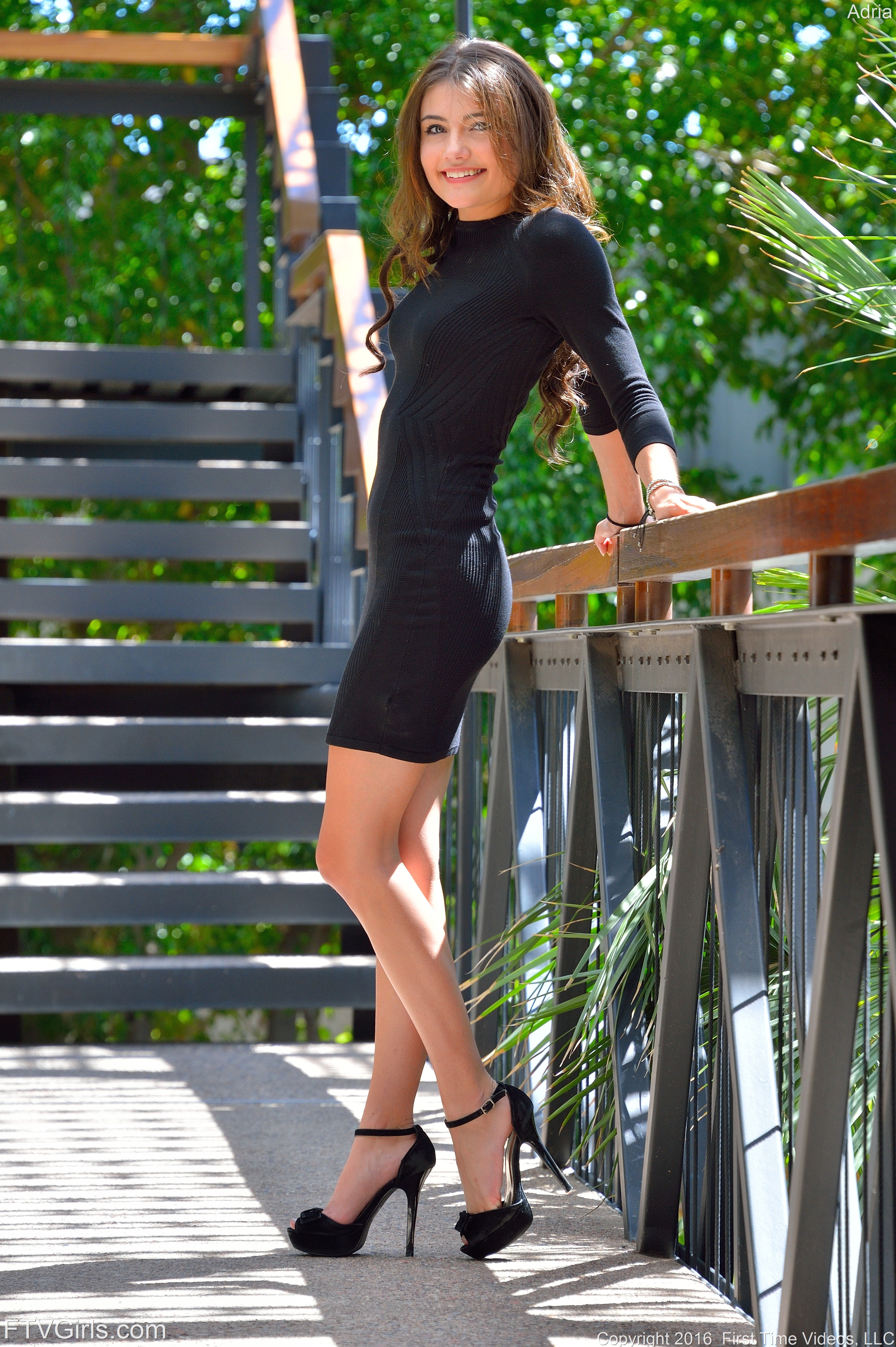 Upskirt teaser Adria Rae strips to a white bra and black ...