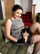 Dressy lady showcases her vintage lingerie and seamed stockings