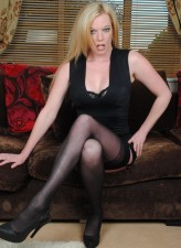 British milf Holly Kiss in black seamed stockings stuffs her box