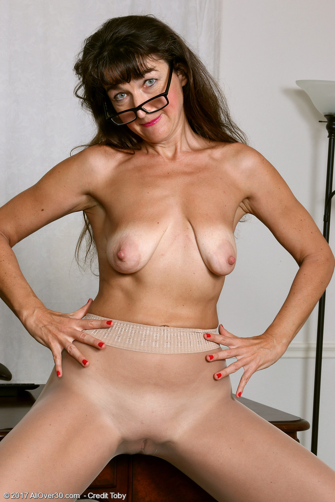 image Spectacled mature strips and makes herself very wet