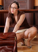 Sexy secretary Fiona wearing glasses. pantyhose and high heels