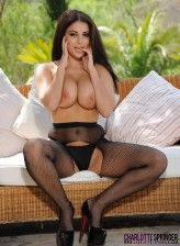 British glamour model Charlotte Springer in sexy black fishnet pantyhose