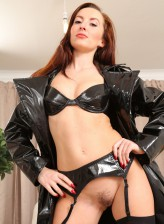 British mistress Sophia Smith wears leather undies and nylons with thigh high boots under her coat