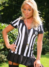 Tasty blonde referee in black opaque stockings stripping outdoors