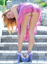 Upskirt flasher strips to her raunchy blue high heels outdoors