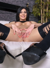 Busty brunette Inna Sirina in black designer opaques thrusts a glass toy deep