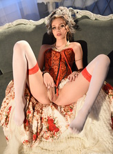 Gorgeous marchesa with perky breasts strips her long skirts, tight red corset and two-tone stockings