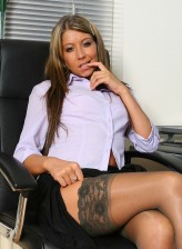 Teasing office amateur Antonia Stokes shows off her hips in stockings