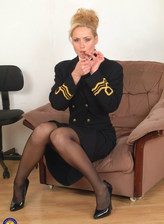 Mature captain Katarina smokes a cig stripping her black uniform and pantyhose