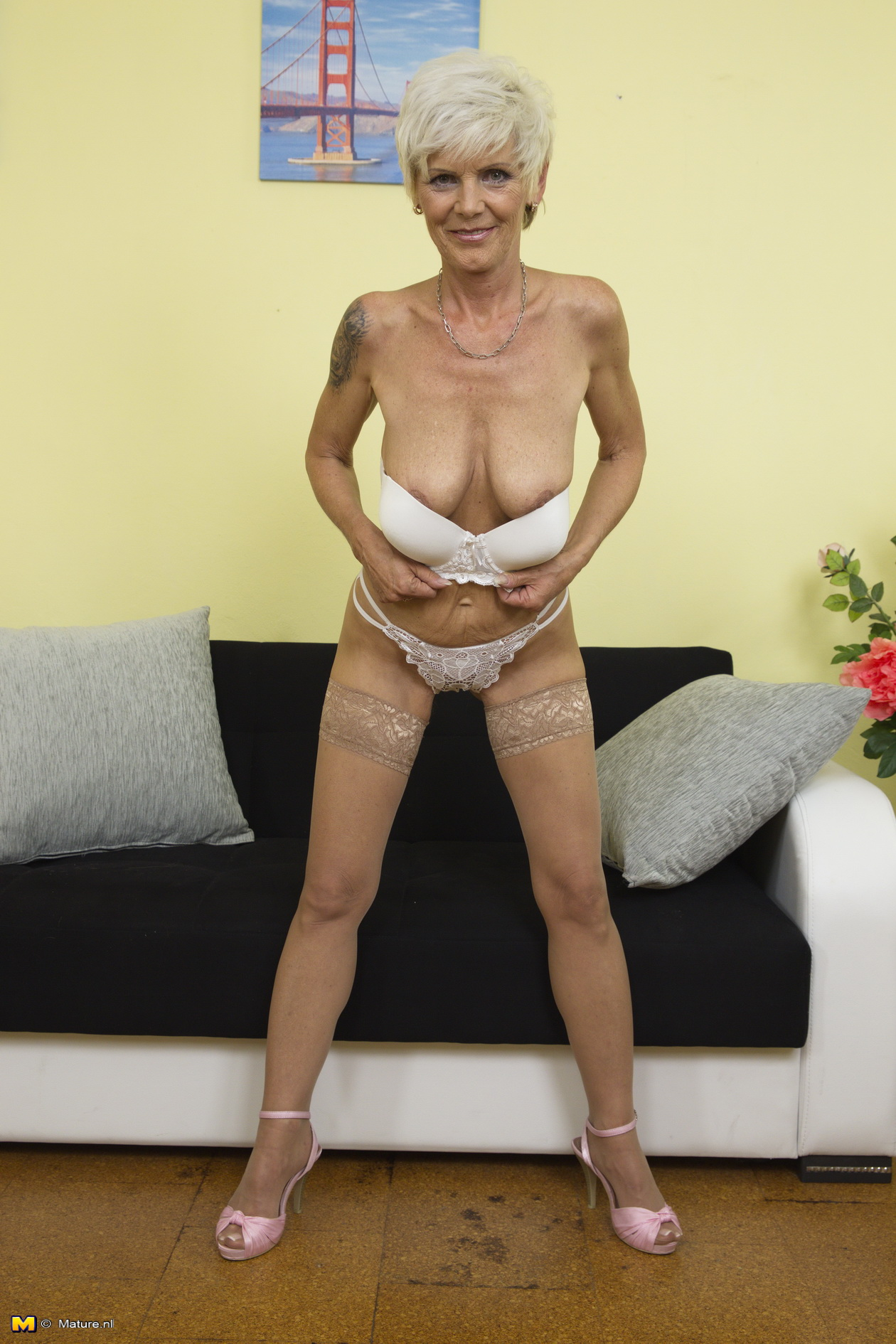 Hot mature strips down to stockings and show off nice ass and pussy 5