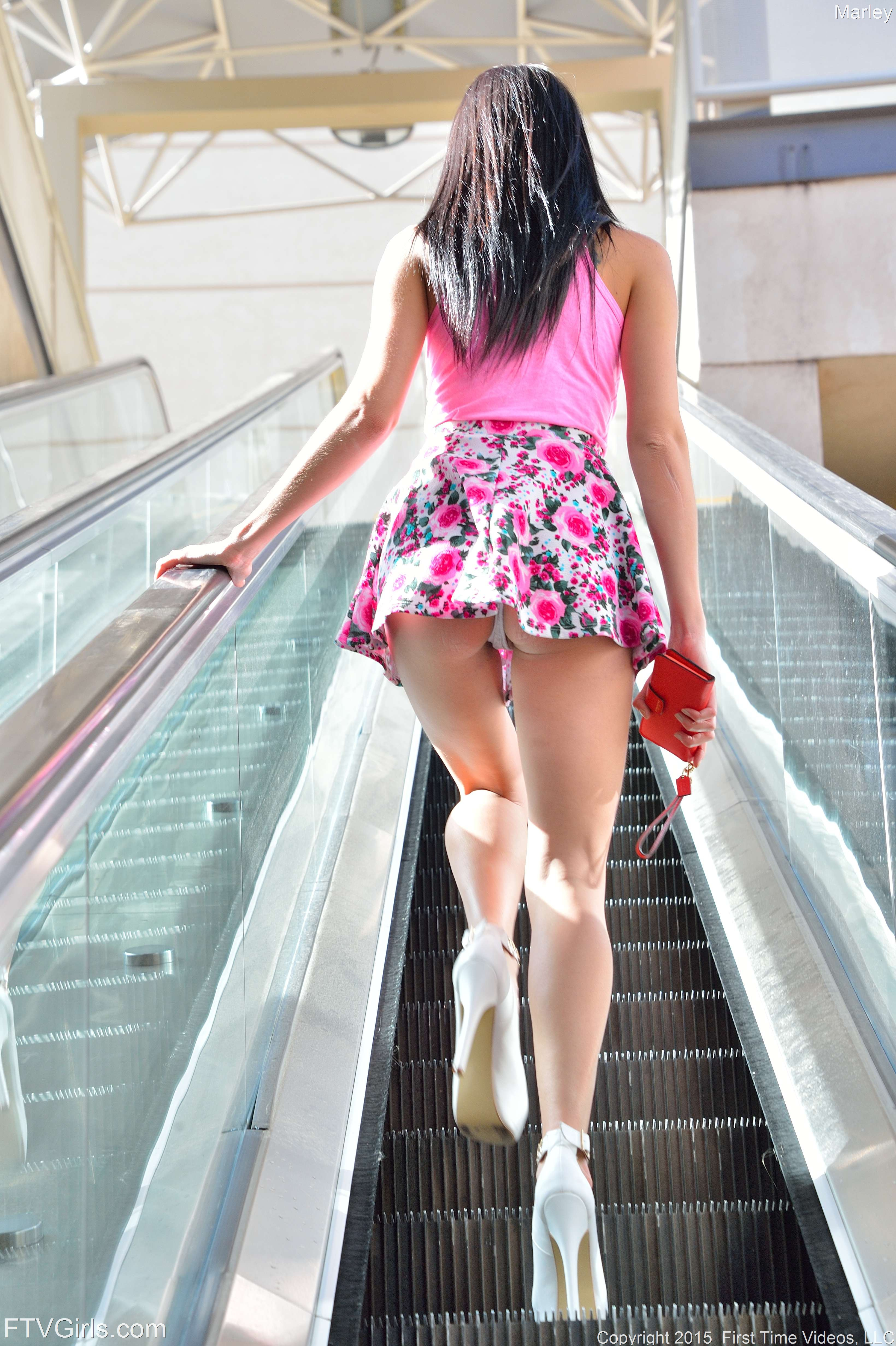Upskirt doll Marley Brinx flashes her panties and spreads legs in platform pumps