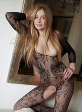 Yummy strawberry blonde in a patterned bodysuit puts on a display her curves and puffy pussy