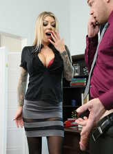 Busty business-lady Karma Rx takes a giant schlong between her stockinged legs