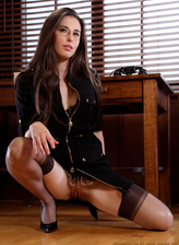 Beautiful office babe Casey Calvert wearing glasses, corset and classy stockings