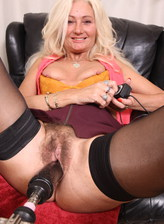 British mom Ellen B. opens her stockinged legs and hairy cunt for a fuck machine