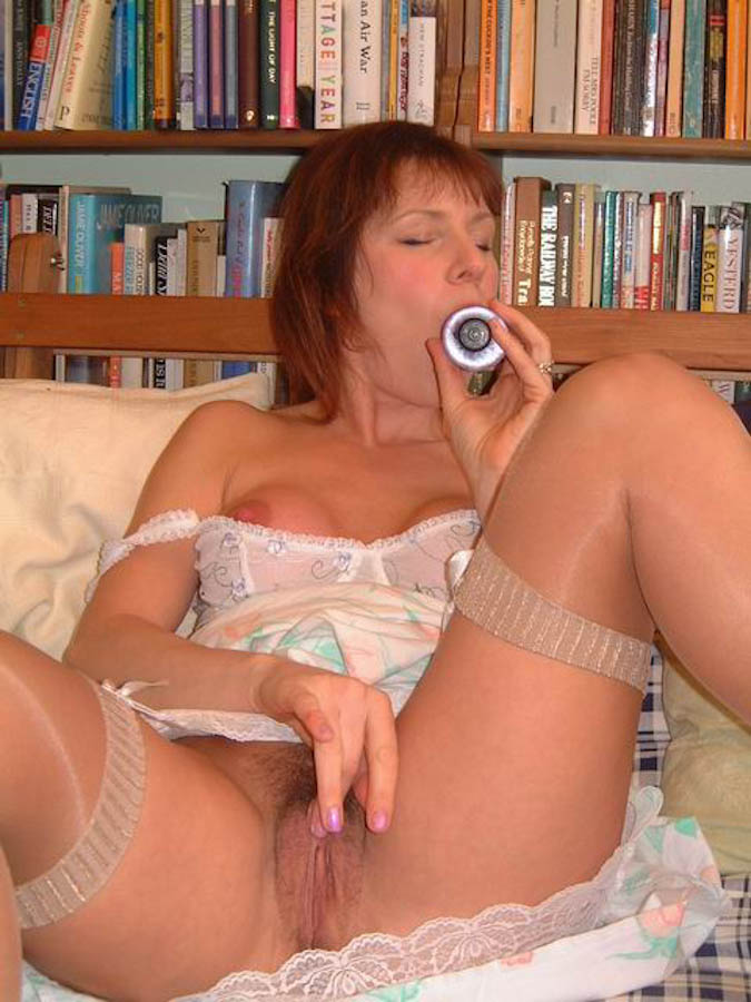 Milf playing with her shiny new toy