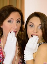 English ladies Lara Latex and Dominica go lesbo in their white gloves and classy black stockings