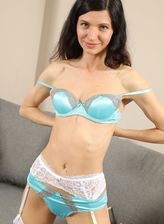 Brunette Lina Arian peels a sky-blue silky set and parts legs in white stockings