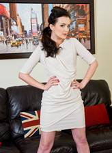 Beautiful UK milf Faye X spread-eagles in white gartered stockings for kinky shoe play
