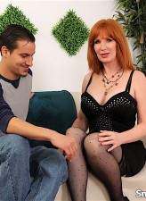 Red-headed milf Freya Fantasia gobbles on young meat and rides it in her patterned holdups and heels