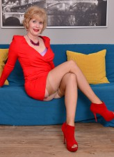 Flamy mature Sindee Dix parades her red heels, lilac lingerie and sheer nylons