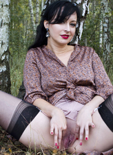 Wanilianna bends and spreads in the woods in her black fully-fashioned stockings