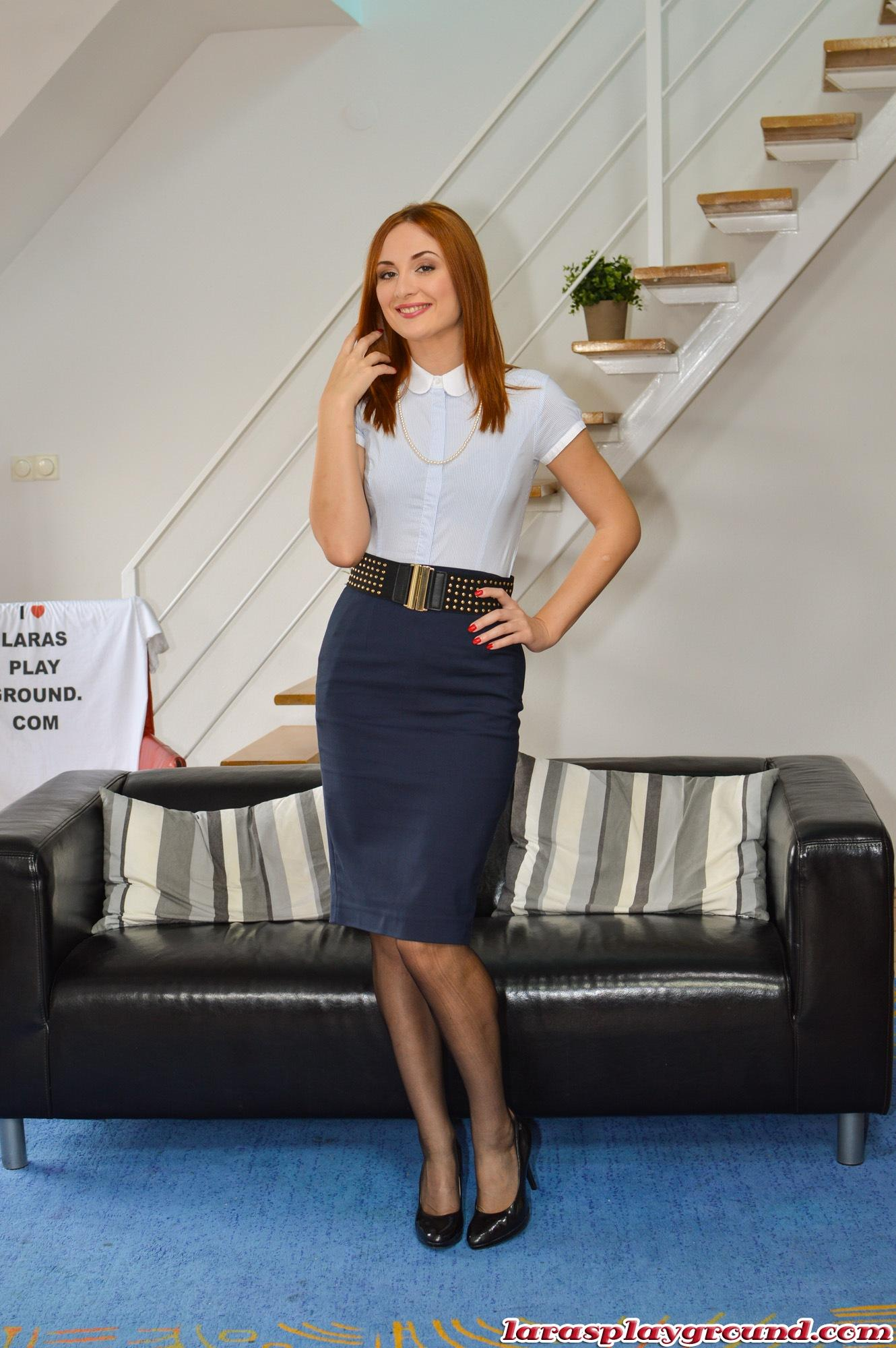 Redhead with black stocking play with dildo 9