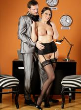 Bigtitted secretary in specs and fine gartered stockings seduces her busy boss into a nylon quickie