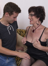 Glasses-wearing mom flashes her cleavage and gets laid by her toyboy wearing stockings and garters