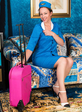 British mature Claire Adams gets dirty in her blue air hostess uniform, white undies and tan nylons