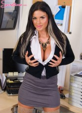 Funky UK secretary Candy Sexton exposes her tats and masturbates in barely there thigh highs