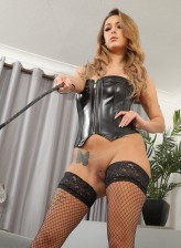 Fishnet clad UK domina Lauren Louise strips off her leather gear holding a crop