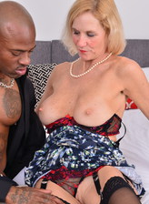 Sex-craving old lady Molly Maracas opens slim stockinged legs for a black stud