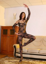 Flexi babe in a black lacy bodystocking gets to sexy gymnastics