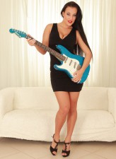Czech rock-babe Carmen Croft strips leopard undies holding a guitar between bare legs in high heels
