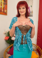 Beautiful redhead mature Irena loves to play alone