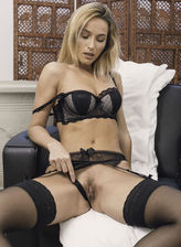 Busty beauty Cara Mell gets too hot in her sexy black lingerie, nylons and heels
