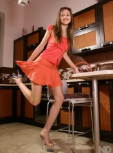 Leggy minx Mariya from Ukraine gets to pantyless upskirt tease in the kitchen