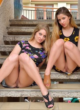 Two leggy upskirt girls in sexy platform sandals wear nothing under their flowery frocks