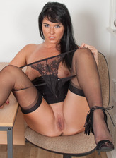 English brunette Raven Lee lowers her tiny lacy thong and opens legs in stockings and stiletto heels