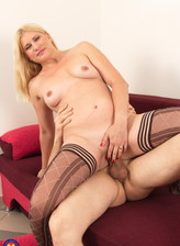 Round-assed mom Calina boasts legs in patterned holdups ready for a cowgirl ride