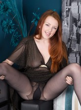 UK ginger-head Jenny Smith teasingly shows off legs and butt clad in sheer black pantyhose