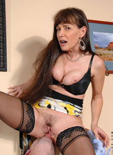 Slim-legged mature Alexandra Silk gets it on in her strappy yellow thong with black bra and nylons