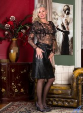 British mature Ellen B. teasingly strips to leopard lingerie and dark stockings to show her big bush