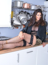 Stacked mom Lulu Lush boasts her stunning cleavage in the kitchen and spreads in fishnets for a toy