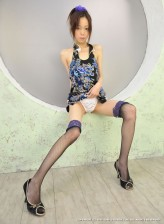 Japanese cutie in two-toned fishnets demonstrates her shaved pussy