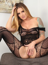 Hot US milf Teagan Presley parts legs for a toy in a sexy open crotch bodysuit