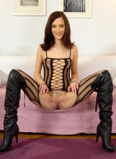 Hot-assed gal wears a net bodystocking under her rubber pants