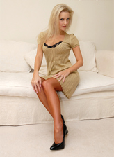 Elegant blonde Vicki Holloway spreads legs for a toy in her tan seamed RHT nylons and classy pumps