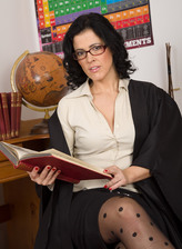 Spectacled professor Montse Swinger sniffs her wet thong and spreads legs in patterned nylons